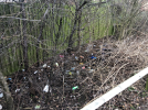 Rubbish and other waste on the pathway from Waterside Close to Thamesmead Centre
