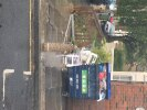 Shopping trolley dumped with loads of rubbish and a matters