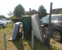 Two mattresses, bed frame, table and other rubbish has been dumped