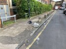 Bin bags abandoned on pavement